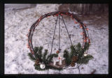 Branch wreath decorated with pine cones and baubles, Logan, Utah, 1999