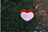 Miranda Lynn Gutierres grave marker with wooden heart decorations in Salt Lake City, Utah, 2000
