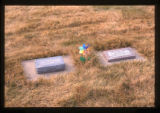 Two infant grave markers and a pinwheel in Ephraim, Utah, 1999