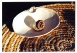 Navajo basket with clam shell and snail shell