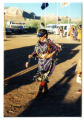 Kahealani Johnson dancing at a powwow in traditional Navajo jingle dress, Bluff, Utah