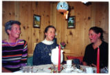 Three Austrian women seated at a table while yodeling in a gamehouse, Salzburg, Austria, 2001 (1...