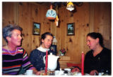 Three Austrian women seated at a table while yodeling in a gamehouse, Salzburg, Austria, 2001 (2...