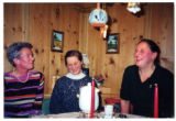 Three Austrian women seated at a table while yodeling in a gamehouse, Salzburg, Austria, 2001 (4...