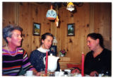 Three Austrian women seated at a table while yodeling in a gamehouse, Salzburg, Austria, 2001 (3...