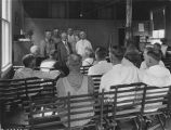 Farmers receiving instruction in a classroom;