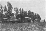 Agricultural exhibit train arriving at West Jordan;