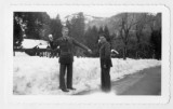 Alfred Erickson and William Barron from Detroit posing with snowballs, in Yosemite National Park,...