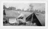 Erickson sitting near a military tent (1 of 2)