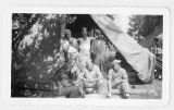 Erickson and four others peeling potatoes in front of army cook tent (2 of 2)