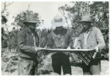 Leonard Jones, Dolph Andrus, and Ozro Hunt check map