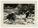 Irene Andrus and Jennie Clement near Augusta (Sipapu) Bridge doing the wash on the rock, 1917