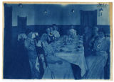 Women sitting at a fancy table setting, (duplicate), ACU, 1896-1916