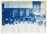 Bottled goods made by students displayed on table. Duplicate of 1:07:13, ACU, 1905