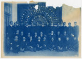 "Group of men in front of specimens (written on back: ""State Fair Exhibit?""). Duplicate..."