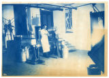 College Dairy, man working the separator, ACU, 1901