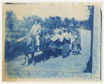 Group of children in cart pulled by water buffalo, location unknown. Duplicate of 1:15:17,...