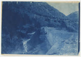 Canal in foreground, mountains and canyon in background. Duplicate of 2:01:04, ACU, 1896-1916