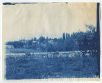 Fence line, road and houses in distance. Duplicate of 2:01:02, ACU, 1896-1916