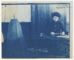 Woman tracing pattern. Duplicate of 8:260, ACU, 1905