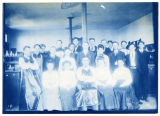 Group of men and women, in chemistry lab(?), some men wearing aprons, ACU, 1896-1916