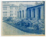 Plants in front of Mechanic Arts building, Old Main in background, looking north, ACU, 1896-1916