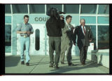 Reporter questioning John Jeppson (right) with Christopher Doerr (left) shown leaving the 1st...