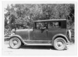 Man driving a Ford automobile, somewhere in the Lewiston (Utah) area, circa 1925-1935