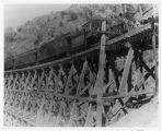 Union Pacific Railroad (Oregon Short Line Railroad) train on wooden trestle in Bear River Canyon...