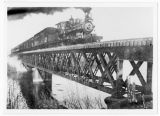 "Tom Hee and his ""Pride"" train ""the Old 400"" crossing the Bear River in Cache..."