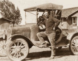 Newell James Crookston posed with automobile