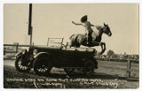 Real photo postcard of Bonnie Grey on King Tut, jumping auto