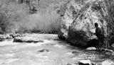 Unidentified man fishing along the Logan River up Logan Canyon, Utah, ca. 1920's