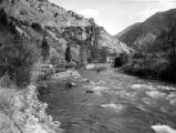 Looking upstream at the Utah Power and Light Company power station and cottages, Logan Canyon,...