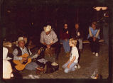 Agins performing around a campfire